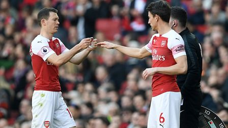 Arsenal's Stephan Lichtsteiner is substituted for Arsenal's Laurent Koscielny during the Premier Lea