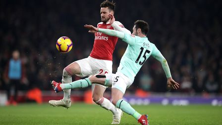 Arsenal's Carl Jenkinson (left) and Bournemouth's Adam Smith (right) battle for the ball during the