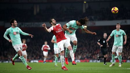 Arsenal's Henrikh Mkhitaryan (left) and Bournemouth's Nathan Ake (right) battle for the ball during
