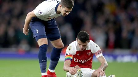 Tottenham Hotspur's Harry Winks (left) has words with Arsenal's Granit Xhaka during the Premier Leag