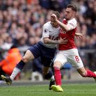 Tottenham Hotspur's Kieran Trippier (left) and Arsenal's Aaron Ramsey battle for the ball during the