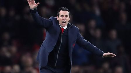 Arsenal manager Unai Emery instructs his players