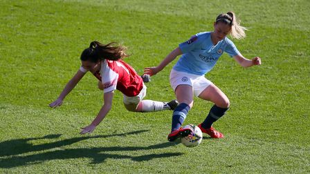 Arsenal's Lisa Evans (left) and Manchester City's Keira Walsh battle for the ball during the FA Wome