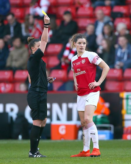 Arsenal's Dominique Bloodworth is shown the yellow card during the FA Women's Continental League Cup