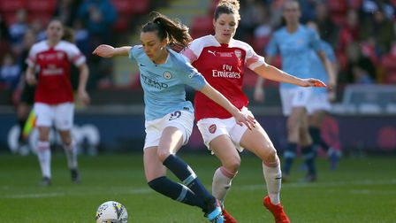 Manchester City's Caroline Weir (left) and Arsenal's Kim Little battle for the ball during the FA Wo