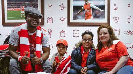 Dad Donald Agala, brother Rio, brave Tye and mum Amy-Rose under a picture of Mesut Ozil