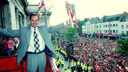 Arsenal manager George Graham celebrates, after the team paraded the European Cup Winner's Cup throu