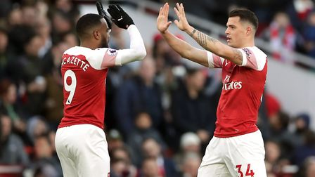 Arsenal's Granit Xhaka (right) celebrates scoring his side's first goal of the game with Alexandre L