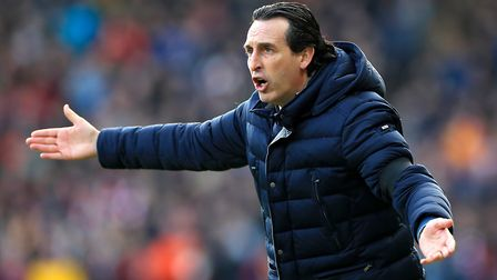 Arsenal manager Unai Emery gestures on the touchline during the Premier League match at the John Smi