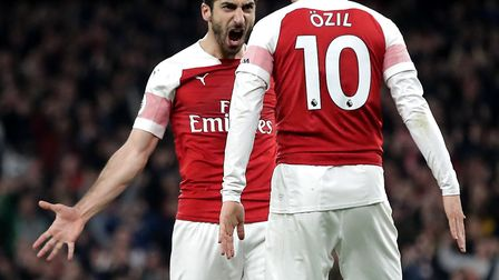 Arsenal's Henrikh Mkhitaryan (left) celebrates scoring his side's second goal of the game with team