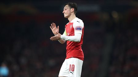 Arsenal's Mesut Ozil applauds the fans after the final whistle