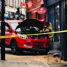 A car collided with Archway Estate agents in Junction Road this morning. Picture: @LPADVA