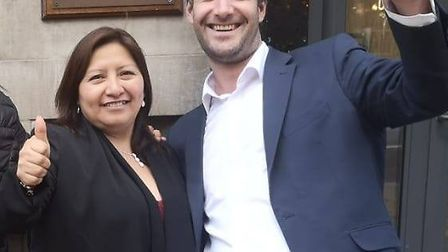 Susana Benavides and Petros Elia celebrate the United Voices of the World unions' victory against Br
