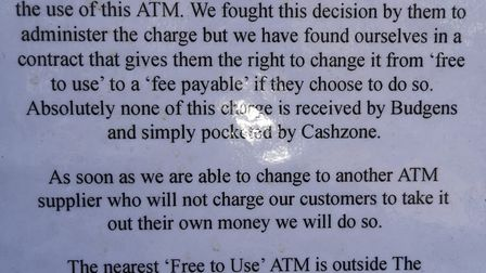 Budgens pinned this disclaimer to the wall near the cashpoints.