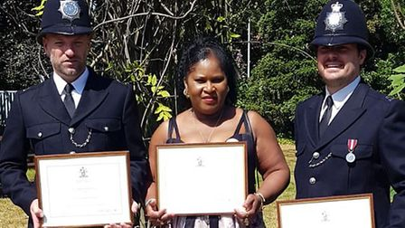 Jessica Plumber with two police officers. Picture: Jessica Plumber