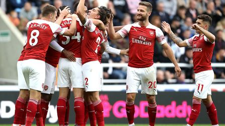 Arsenal's Mesut Ozil (not visible) celebrates scoring his side's second goal of the game with team m