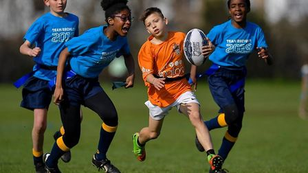 An Islington youngster in tag rugby action (pic Ying Pan Wu)