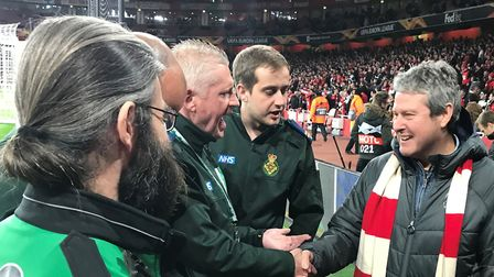 Bruce McKenzie at the Emirates Stadium with the medics who 'saved his life'. Picture: St John Ambula