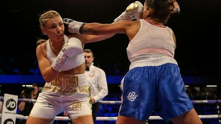 Shannon Courtenay (left) in action against Cristina Busuioc during their Bantamweight bout at the Co