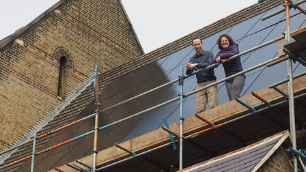 Rev Gabriel Anstis and Catherine Ross on the roof of the church.