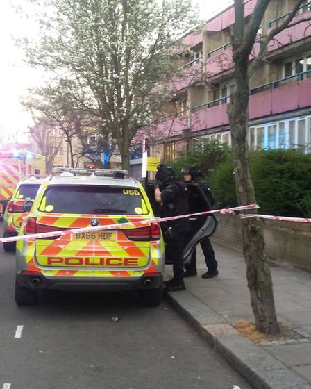 Police, firearm crews and helicopers called to police standoff in Kilburn. Picture:@LifeinKilburn