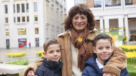 Paola Domizio and her two sons attends the Marie Curie Garden of Light 2017 in London. Paola was a