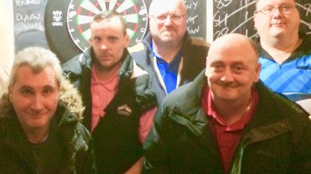 Archway Darts league players pose for the camera (Pic: James Martin)