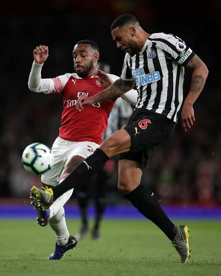 Arsenal's Alexandre Lacazette and Newcastle United's Jamaal Lascelles battle for the ball (pic Adam