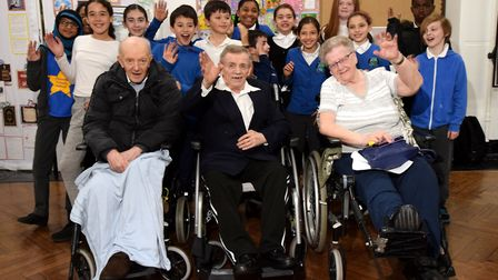 Pupils from Year 6 welome their guests from Muriel Street Care Home. Front, from left Richard Cleary