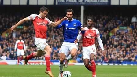 Everton's Andre Gomes (centre) battles for the ball with Arsenal's Sokratis Papastathopoulos (left)