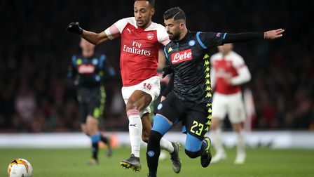 Arsenal's Pierre-Emerick Aubameyang (left) and Napoli's Elseid Hysaj battle for the ball during the