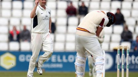 Middlesex' Tim Murtagh celebrates after team mate Sam Robson catches out Northamptonshire's Alex Wak