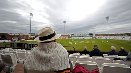 A spectator watches the play during day one of Specsavers County Championship Division Two match at