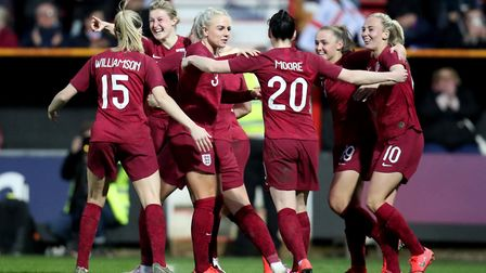 England's Ellen White celebrates with her team-mates after she scores to put her side 2-0 up during