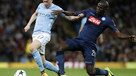 Manchester City's Kevin De Bruyne is brought down by Napoli's Kalidou Koulibaly during the UEFA Cham