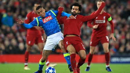 Napoli's Marques Allan (left) and Liverpool's Mohamed Salah battle for the ball during the UEFA Cham