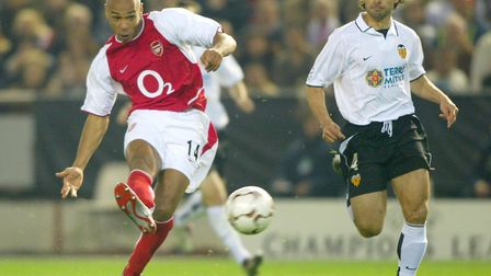 Arsenals's Thierry Henry scoring past Valencia's Fabian Ayala, during their Champions League 2nd Rou