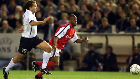 Valencia's Ruben Baraja (left) battles for the ball with Arsenal's Bisan Wiltord during the UEFA C