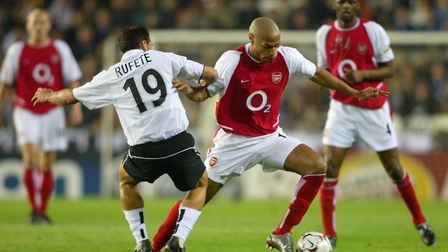 Arsenals's Thierry Henry, goes past, Valencia's Rufete, during their Champions League 2nd Round matc