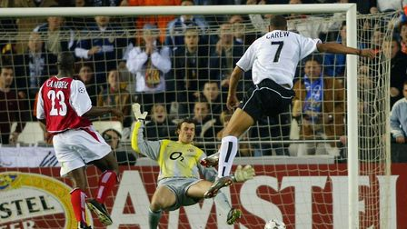 Valencia's John Carew scores past Arsenal keeper Stuart Taylor and Sol Campbell, during their Champi