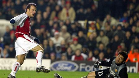 Arsenal's Freddie Ljungberg (left) and Valencia's goalkeeper Palop, during their Champions League m