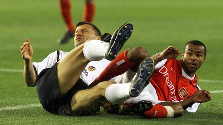 Valencia's Miroslav Djukic (left) and Arsenal's Ashley Cole collide while going for the ball during