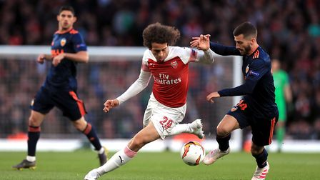 Arsenal's Matteo Guendouzi and Valencia's Jose Luis Gaya (right) battle for the ball during the UEFA