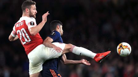 Arsenal's Shkodran Mustafi (left) and Valencia's Goncalo Guedes battle for the ball during the UEFA