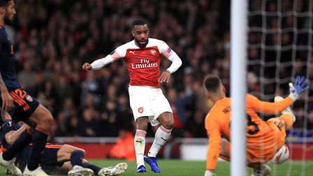 Arsenal's Alexandre Lacazette has a shot saved by Valencia goalkeeper Neto during the UEFA Europa Le
