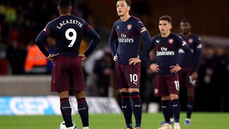 Arsenal's Alexandre Lacazette, Mesut Ozil and Lucas Torreira (left-right) stand dejected after conce