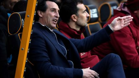 Arsenal manager Unai Emery (left) on the bench during the Premier League match at Molineux, Wolverha