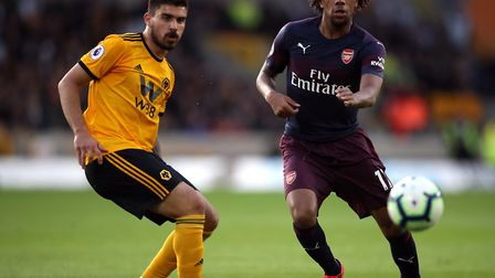 Wolverhampton Wanderers' Ruben Neves (left) and Arsenal's Alex Iwobi during the Premier League match