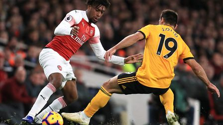 Arsenal's Alex Iwobi (left) and Wolverhampton Wanderers' Jonny Castro battle for the ball during the