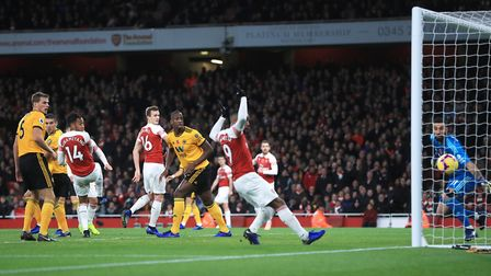 Arsenal's Henrikh Mkhitaryan (not shown) scores his side's first goal of the game during the Premier